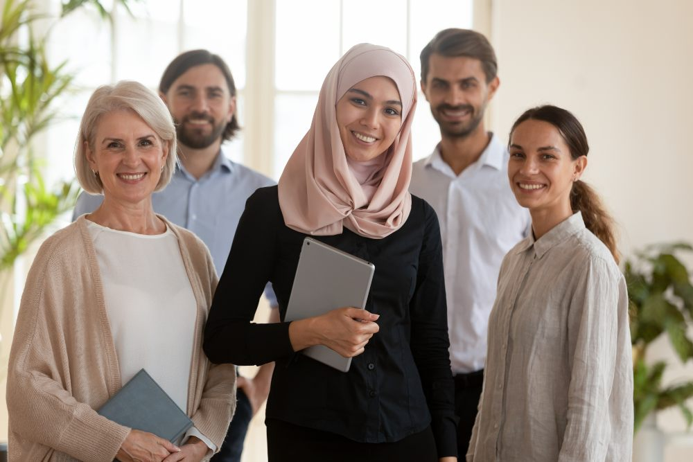 TAFE partnership- image of a group of three smiling women in front of two smiling men